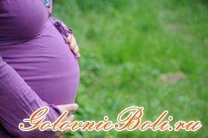 Животик беременной